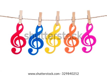 clip on a  twine , hanging colorful music clef artist - stock photo