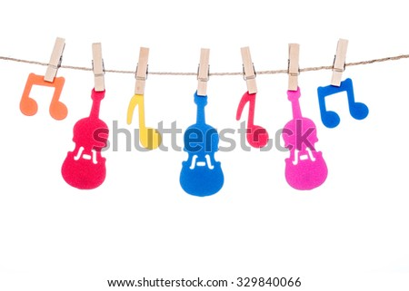 clip on a  twine , hanging colorful music symbol and Guitar artist - stock photo