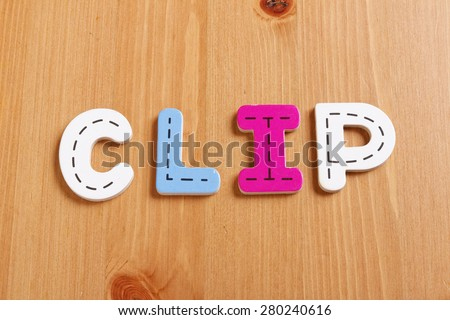CLIP, spell by woody puzzle letters with woody background - stock photo