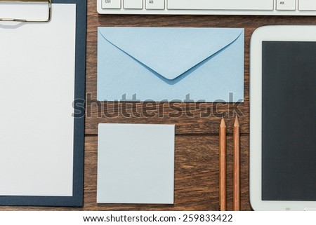 Clipboard, envelope and tablet with blank screen - stock photo