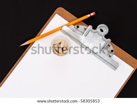 Clipboard with Blank Sheet and Medicine - stock photo