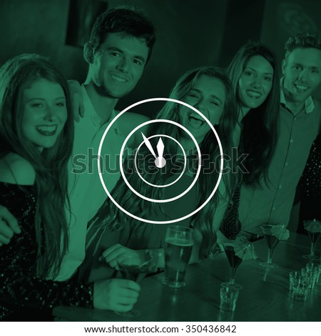 Clock against happy friends on a night out together - stock photo