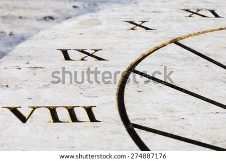 Clock ancient sunlight with Roman numerals engraved - stock photo