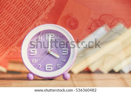 clock and books on a bookshelf background