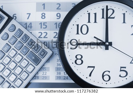Clock and calculator on calendar background