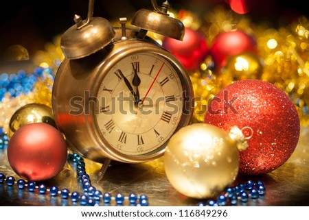 Clock and christmas balls - holiday background - stock photo