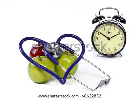 Clock and heart health apples and stethoscope with text space - stock photo