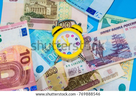 Clock and money.Time is money.Save and travel concept.