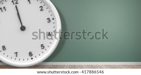 Clock at midnight against room with wooden floor