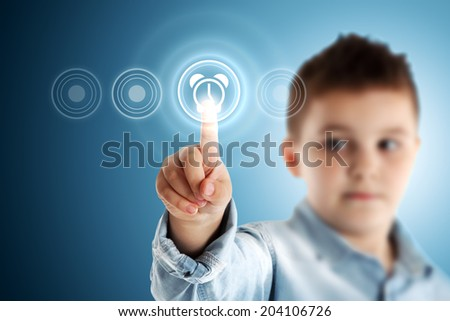 Clock. Boy pressing a virtual touch screen. Blue background. - stock photo