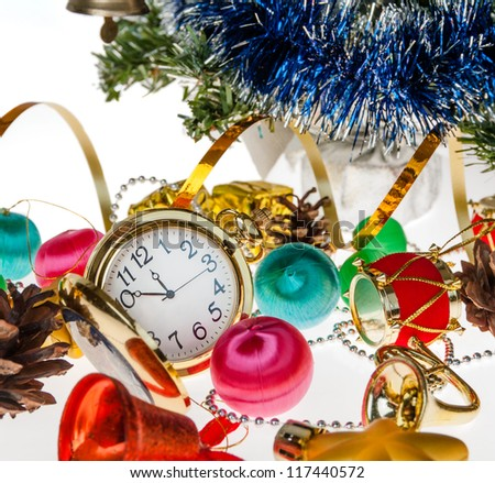 clock,Christmas decorations on the background of a Christmas tree on the white
