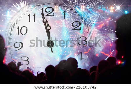 Clock close to midnight, fireworks and crowd waiting for New year - stock photo