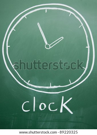 clock drawing on the blackboard - stock photo