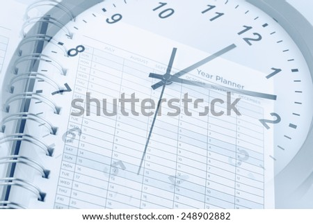 Clock face and year planner page - stock photo
