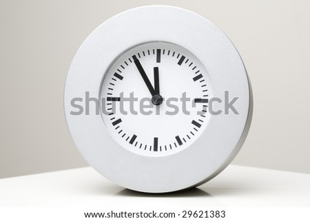 Clock - five to twelve - stock photo