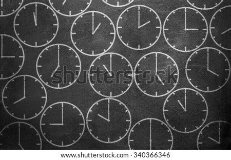 Clock from chalk on black chalkboard background texture - stock photo