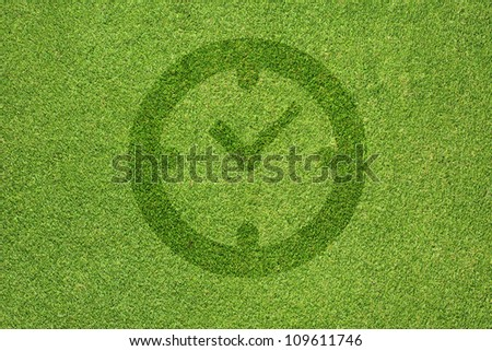 Clock icon on green grass texture and  background