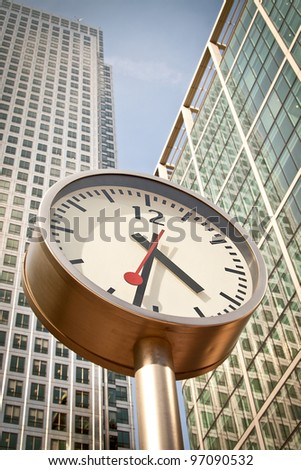 Clock in Canary Wharf in London's financial district. - stock photo