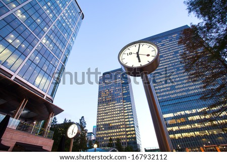 Clock in Canary Wharf in London's financial district office building, time in business concept  - stock photo