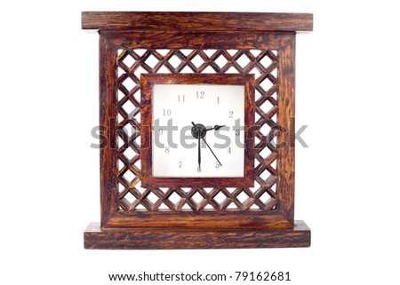 Clock in carved wood frame isolated on white - stock photo