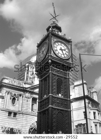 Clock in front of Victoria Station. - stock photo