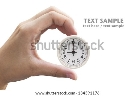 Clock in hand (with clipping path) - stock photo