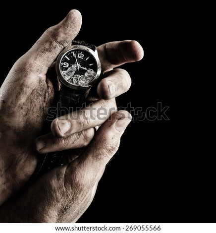 Clock in male hands on black background