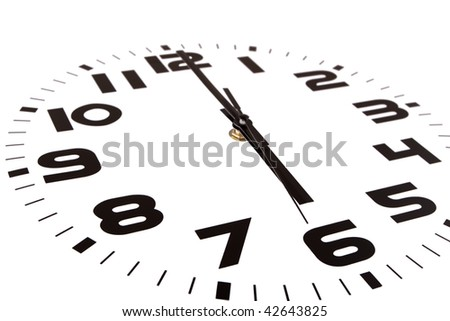 Clock isolated on white marking the six o'clock hour. The main focus is in the hour hand. - stock photo
