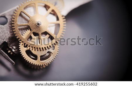 Clock mechanism macro shot with metal gold cogwheels.Conceptual photo for your successful business design.Copy space included. - stock photo