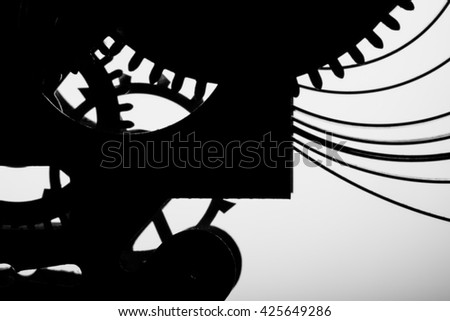Clock mechanism on grey background. Focus on the central gears. High resolution. - stock photo