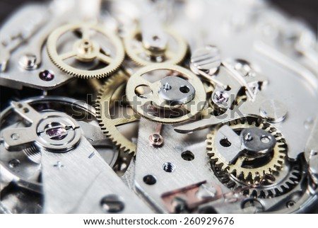 clock mechanism. Very shallow depth of field. Focus on the central gears - stock photo