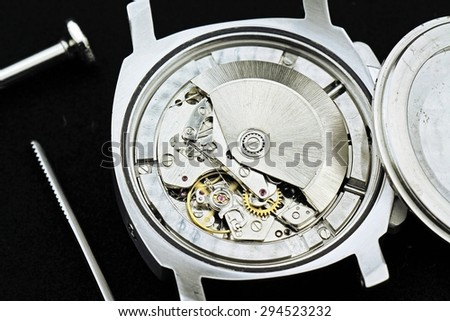 Clock mechanism with gears, watch movement, Detail of clock parts for restoration. - stock photo