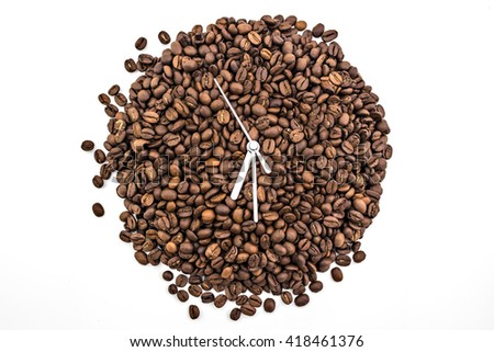 Clock of coffee grains isolated on white background. Coffee beans in clock symbol pointed at six thirty - stock photo