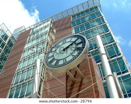 clock on a building in downtown Grand Rapids - stock photo