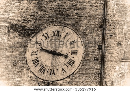clock on a wall in retro tone effect - stock photo