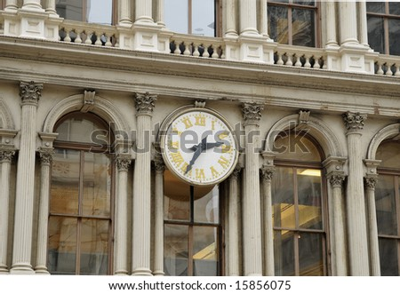 Clock on building in SoHo district, New York City - stock photo