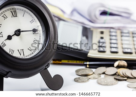 Clock on financial desk,concept of busy or working overtime - stock photo