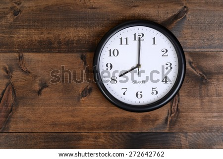clock on old wood - stock photo