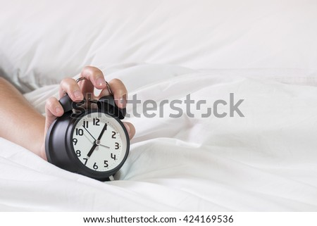 Clock on the bed in the morning, I woke up./made to concept