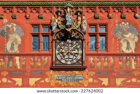 Clock on the wall of the city hall in Basel, Switzerland - stock photo