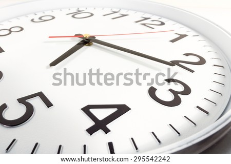 Clock or time abstract background. white clock with red and black needles