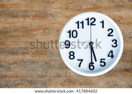 Clock show 5 am or pm and 30 minute on wood background with copy space. clipping path in picture. - stock photo