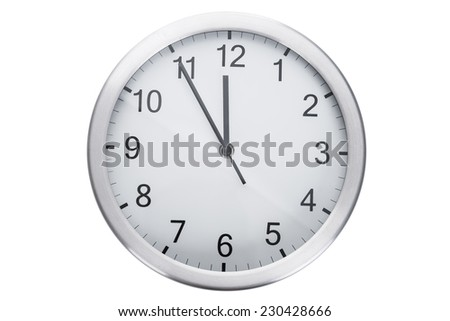 Clock showing five minutes to twelve against white background - stock photo