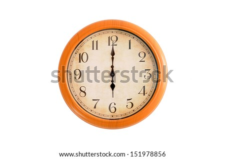 Clock showing 6 o'clock on a white wall