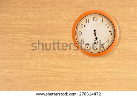 Clock showing 5:30 o'clock on a wooden wall - stock photo