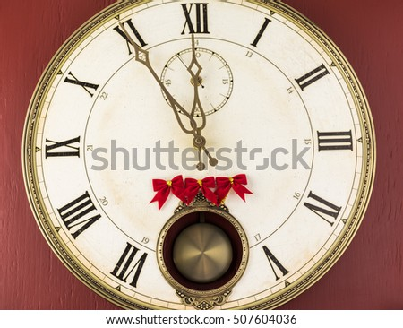 Clock shows five minutes till New Year.