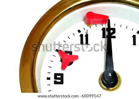 Clock. Time shows less seconds to twelve. A flag is just before fallen down. - stock photo