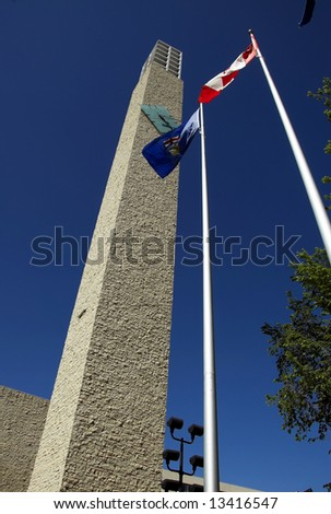 Clock tower and flags at Edmonton's City Hall - stock photo