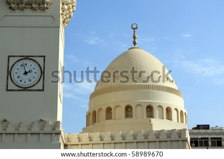 Clock tower and mosque in Manama city, Bahrein - stock photo