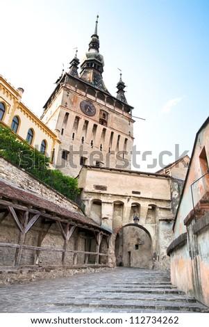 Clock Tower at Sighisoara Citadel in Sighisoara,  saxon landmark of Transylvania, Romania - stock photo